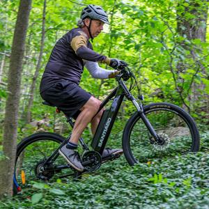 A Cyclist riding the Slane Santiago E-bike on the trail.