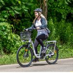 A girl having fun riding the Slane Victoria E-Bike